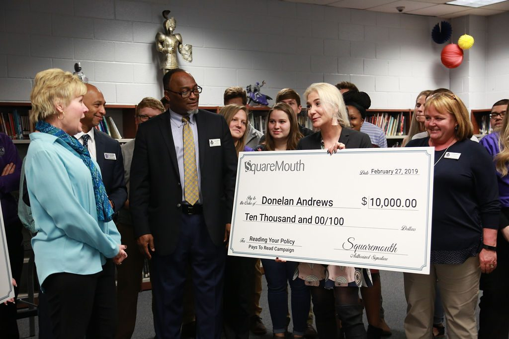 Pays to Read group showing a large check