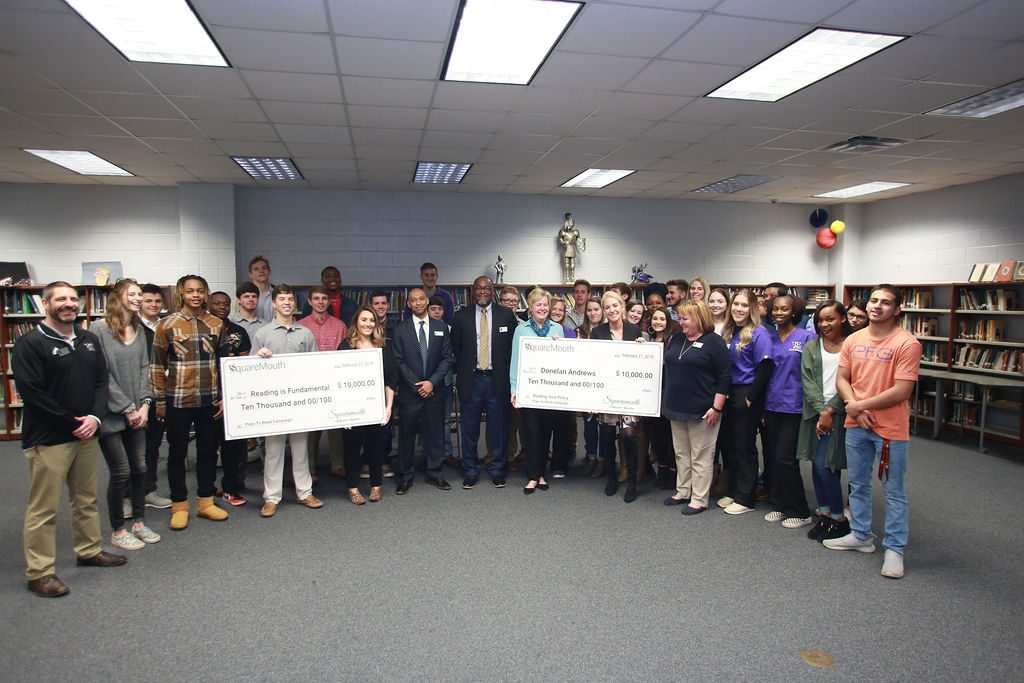 Pays to Read group holding checks